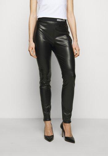 HONATI - Leggings - Trousers - black