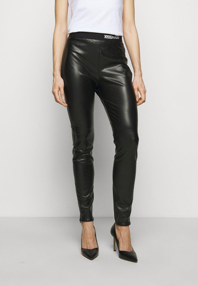 HUGO - HONATI - Leggings - Trousers - black