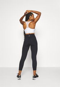 Under Armour - MERIDIAN CROP - Medias - black