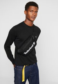 Timberland - SLING BAG - Bum bag - black - 1