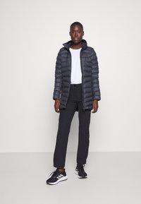 Salomon - SIGHT STORM HOODIE  - Winter coat - ebony - 1