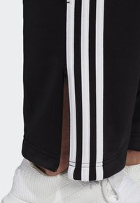 adidas Originals - FIREBIRD ADICOLOR TRACK PANTS - Tracksuit bottoms - black - 4