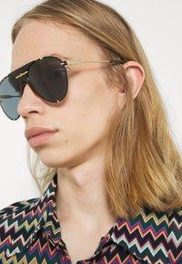 Gucci - Sunglasses - gold-coloured/blue - 1