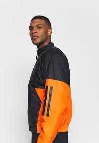 adidas Performance - Outdoor jacket - black/orange - 3