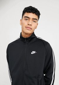 Nike Sportswear - TRIBUTE - Træningsjakker - black - 4