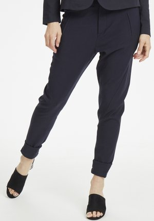 NICOLESZ  - Trousers - deep blue