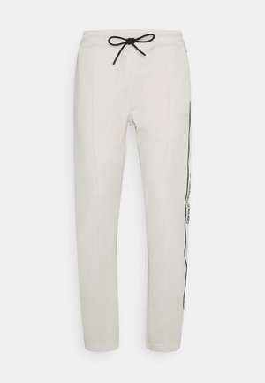 WIDE TRACKPANTS UNISEX - Tracksuit bottoms - whisper white