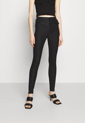 COATED ZIP PANTS - Pantalones - black