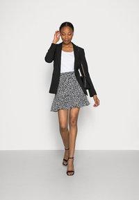 Marks & Spencer London - SOFT SKI - A-line skirt - black - 1