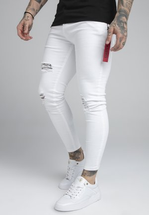 DISTRESSED FLIGHT - Vaqueros pitillo - white