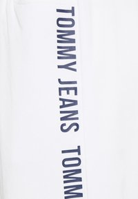 Tommy Jeans - JOGGER TAPE RELAXED - Tracksuit bottoms - white - 6