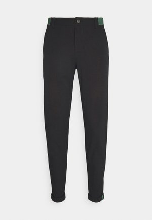 PIN ROLL PANT - Trousers - black
