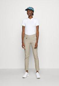J.LINDEBERG - KENZIE GOLF - Print T-shirt - white - 1