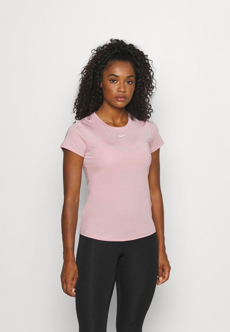 Nike Performance - ONE SLIM - Basic T-shirt - pink glaze/white