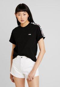 Fila - ADALMIINA TEE - Print T-shirt - black - 0