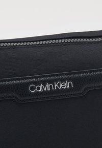 Calvin Klein - WASHBAG - Trousse de toilette - black - 3