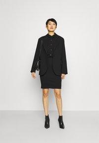 Anna Field - Mini punto smart comfy skirt - Pencil skirt - black - 1