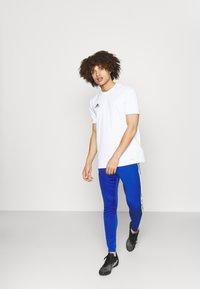 adidas Performance - SQUAD - Tracksuit bottoms - team royal blue/team solar yellow - 1