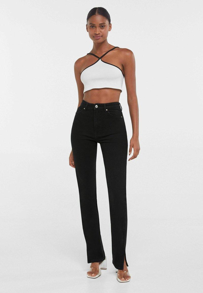 Bershka - SCHLITZ - Jeans straight leg - black
