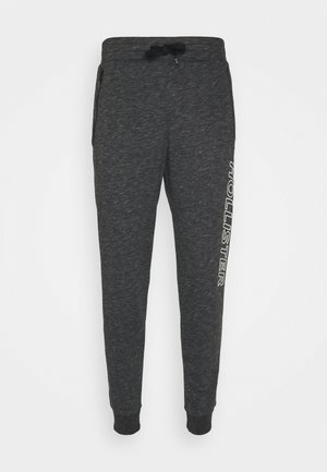 SPORT TAPE - Tracksuit bottoms - textural black