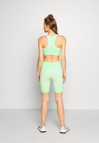 ONLY Play - ONPMASHA LIFE CIRCULAR SHORTS - Leggings - green ash - 2