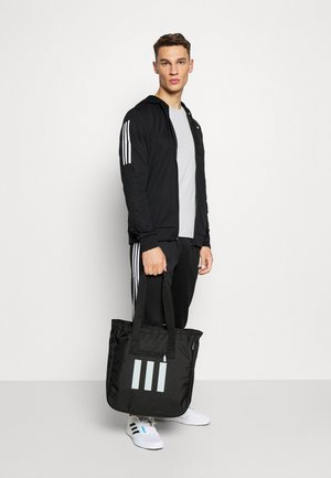 TOTE - Sports bag - black/white