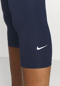 Nike Performance - ONE - 3/4 sports trousers - obsidian/white - 3