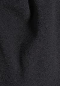 Reebok - OUTERWEAR QUARTER-ZIP TOP - Fleece jumper - black - 8