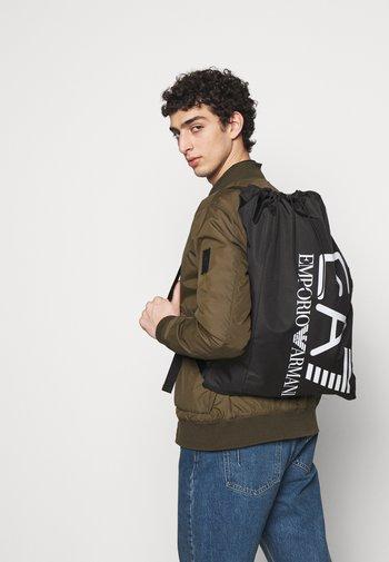 HOLDALL - Sports bag - black/white