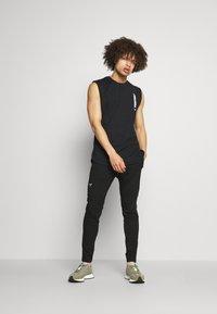 SQUATWOLF - LIMITLESS JOGGERS - Pantalon de survêtement - black - 1