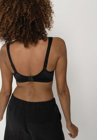 DORINA - Sports bra - black - 4