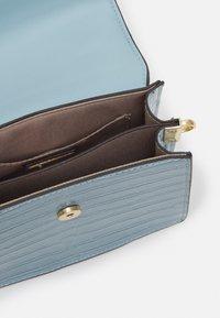 ALDO - TRIEWIEL - Handbag - cashmere blue - 2