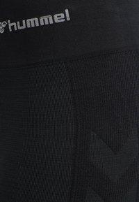 Hummel - HMLCLEA - Leggings - black melange - 12