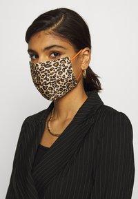 Codello - COVER UP LEO - Masque en tissu - brown - 2