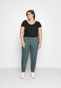 Nike Sportswear - PANT TREND PLUS - Tracksuit bottoms - hasta/white - 1