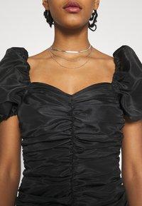 NA-KD - PUFFY SLEEVE DRAPED MINI DRESS - Cocktail dress / Party dress - black - 5