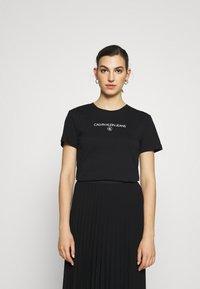 Calvin Klein Jeans - ROUND TEE - Print T-shirt - black - 0