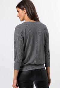 zero - Long sleeved top - black - 2