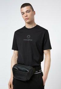 HUGO - ROCKET GR - Bum bag - black - 1