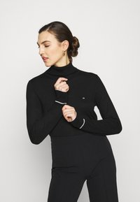 Calvin Klein - ROLL NECK - Strikkegenser - black - 0