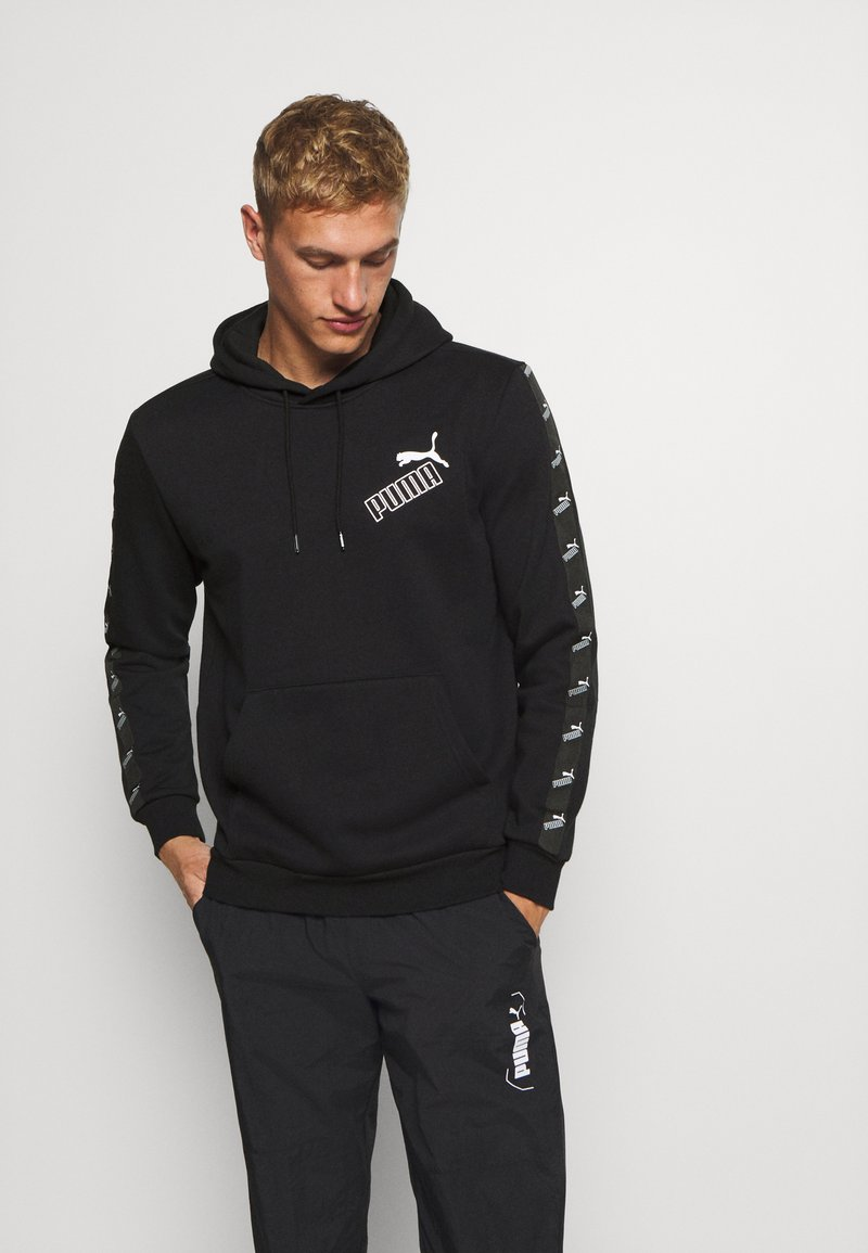 Puma - AMPLIFIED HOODIE - Sweat à capuche - black