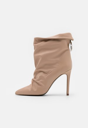 High heeled ankle boots - camel beige