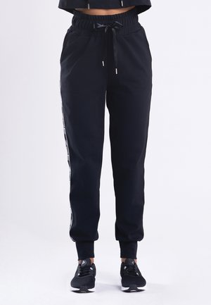 MY STRIPES - Tracksuit bottoms - black