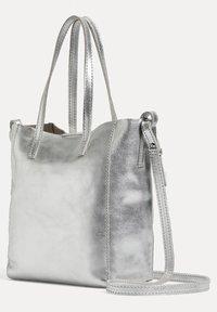 OYSHO - METALLIC LEATHER MINI SHOPPER - Handbag - silver - 1
