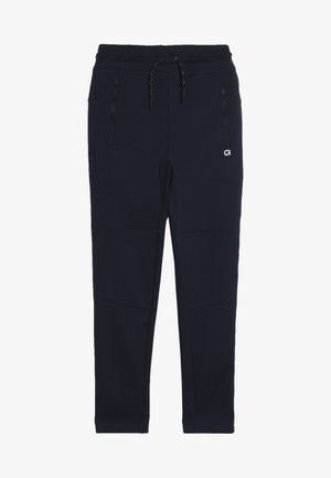 BOY FIT TECH - Tracksuit bottoms - tapestry navy