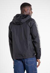 Vans - GARNETT - Training jacket - black-checkerboard - 2