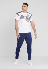 adidas Performance - CORE - Tracksuit bottoms - dark blue/white - 1