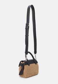 KARL LAGERFELD - IKON MINI TOP HANDLE - Across body bag - natural/black - 2