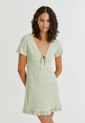 MIT VOLANT AM SAUM - Day dress - green