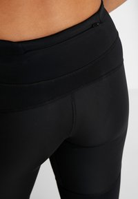 Nike Performance - EPIC LUX - Legginsy - black/reflective silver - 3